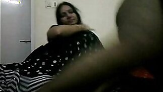 .tamil bhabhi in black indian saree giving her hubby a blowjob on live cam show